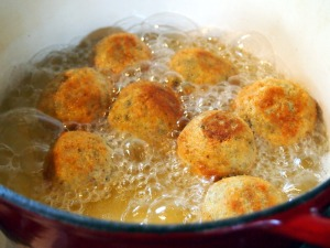 Frying the arancini- don't crowd the pot.