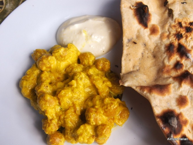 chappati cooked on open fire, raita, chick pea curry.