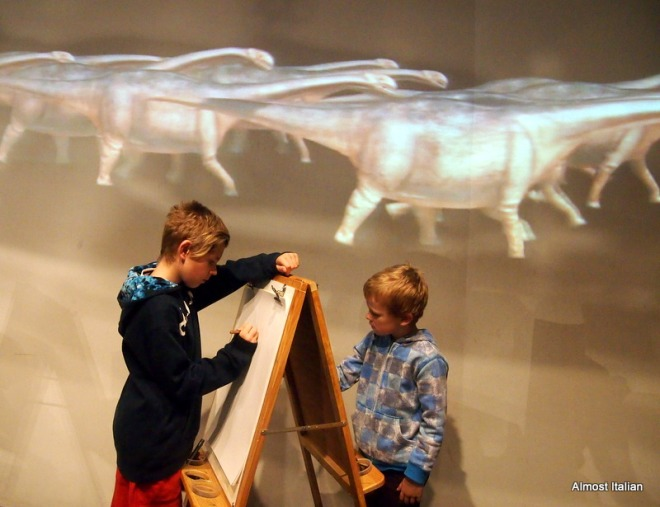 Images of Dinasaur families strolling by  are projected onto the wall. More art for the boys.