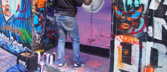 Graffiti lanes of Melbouren. An artist prepares to redo a door.