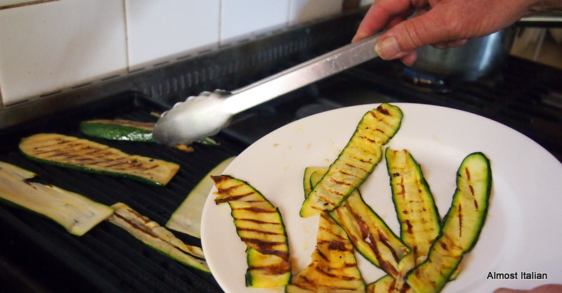 Mr T grills the zuchini and cooks the sauce.