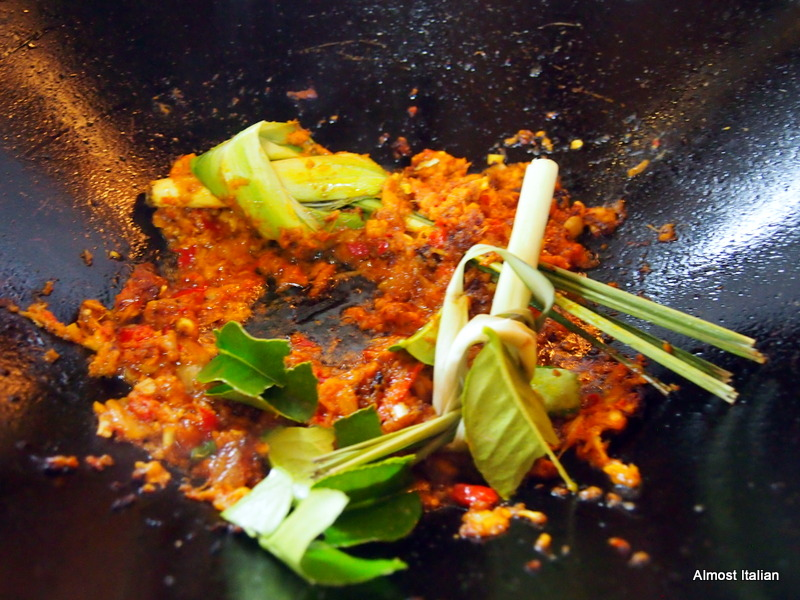 Cook the curry paste in oil, adding lime leaves and lemon grass.