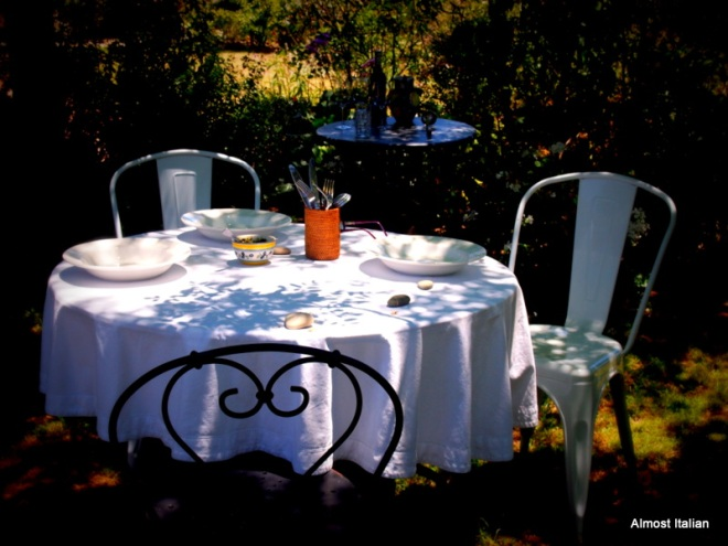 A casual table setting under the trees.