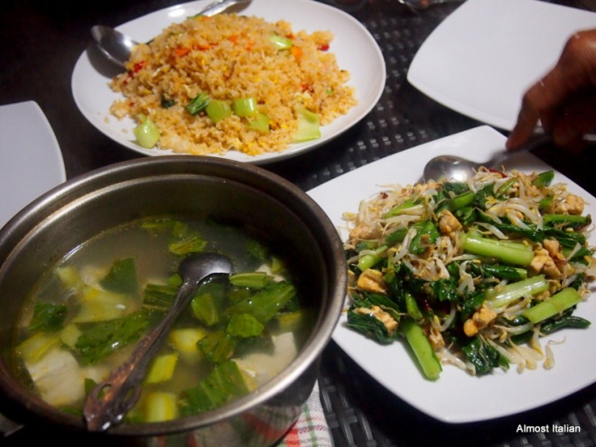 Fried rice, vegetable stir fry, soup of tofu and greens.