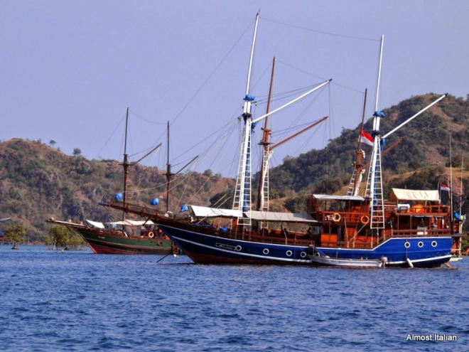Yachts floating in the Komodo sea near Kanawa Island.