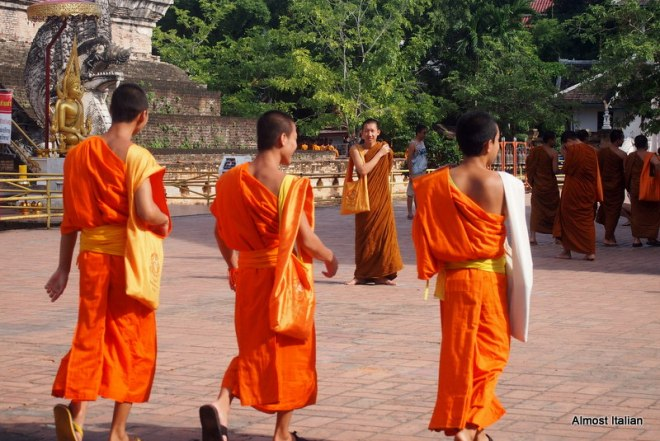 Monks leave the temple grounds of Wat Chedi Luang on their way to class.