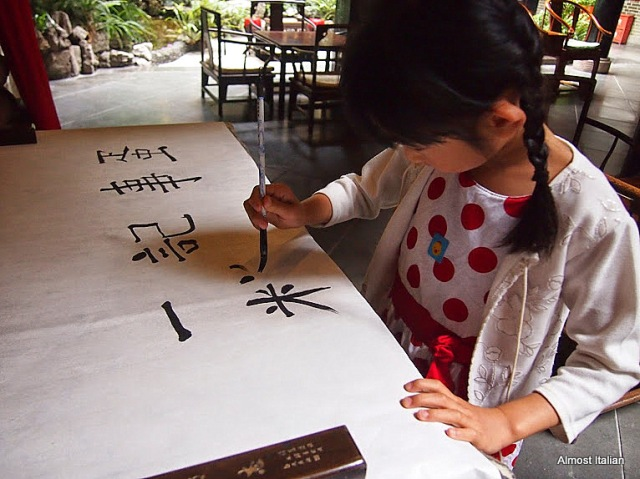 Concentrating on Writng letters. A friends child, 6, practices calligraphy.