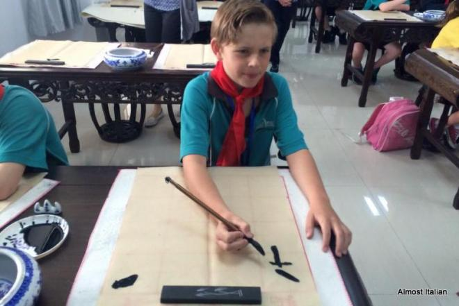 My grandson, at school n China, leaning calligraphy.
