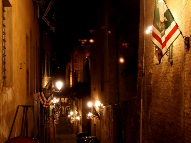 the flags of L'oca adorn the streets of it's contrada.
