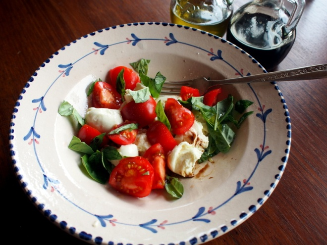 Breakfast. Home grown tomatoes and basil, torn bocconcini, olive oil, salt.
