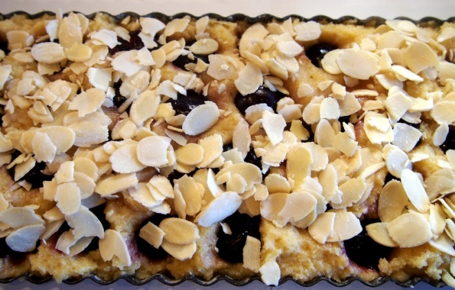 Scatter top with almond flakes then bake.