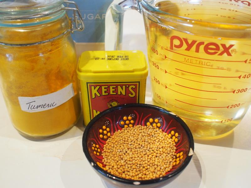 Basic pickle ingredients. Sugar, vinegar, turmeric, mustard powder, mustard seeds.