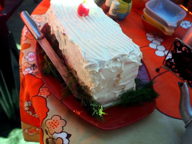 The savoury birthday cake, a carved out loaf of white bread, filled with layers of curried egg, beetroot cream and crab, then covered in cream cheese.