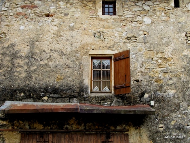A window in the village of St Michelle D'Euzet, Languedoc