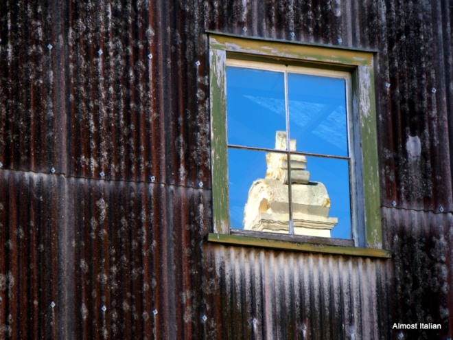 Rust corragted iron shed with window, Oamaru