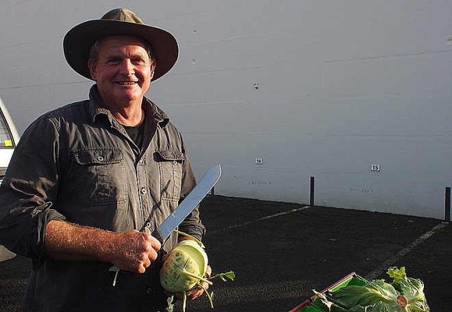 Happy and Handsome Invercargill farmer offers me a slice of fresh kohlrabi.