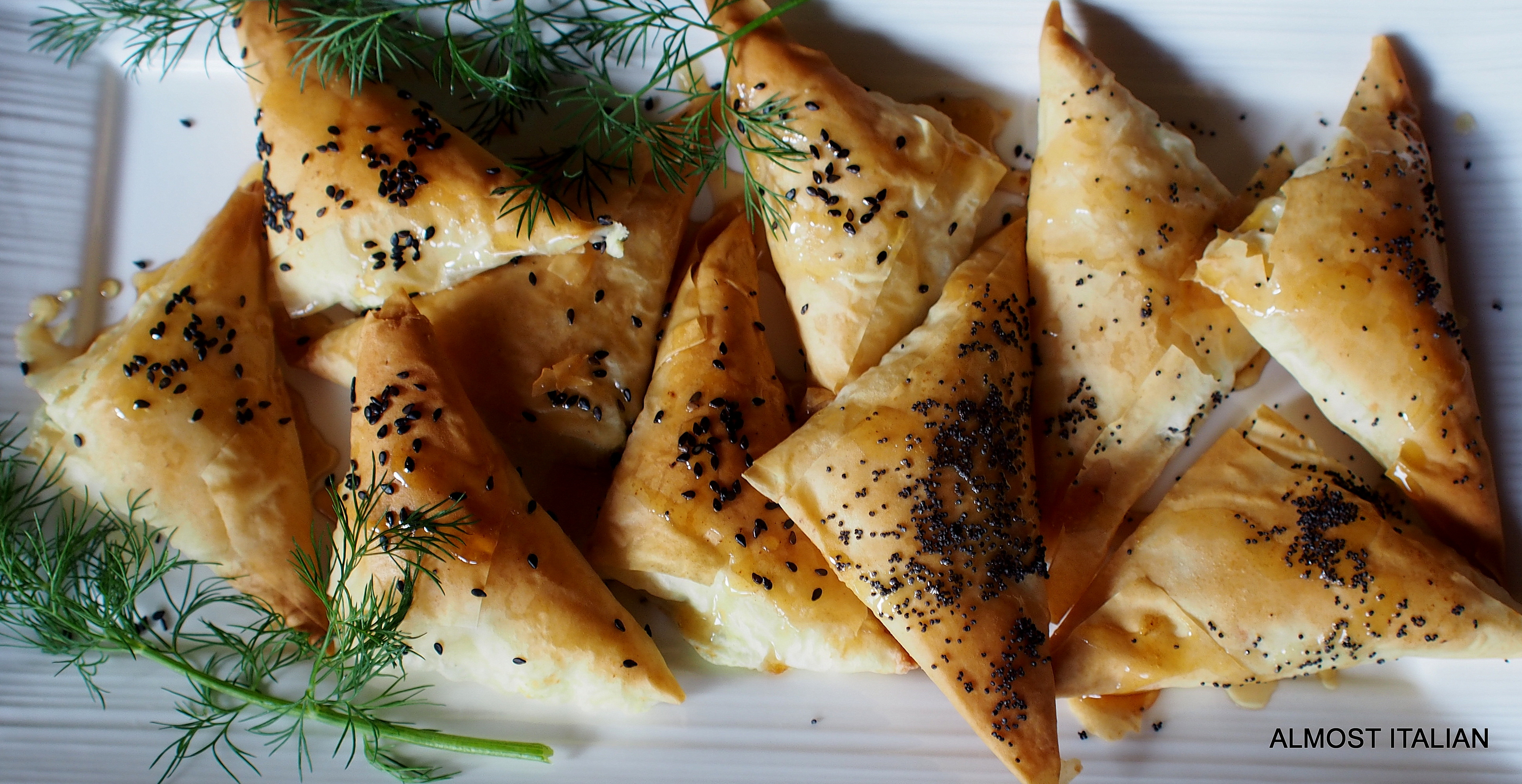 filo pastry with baked pumpkin, goats cheese, herbs, honey drizzle.