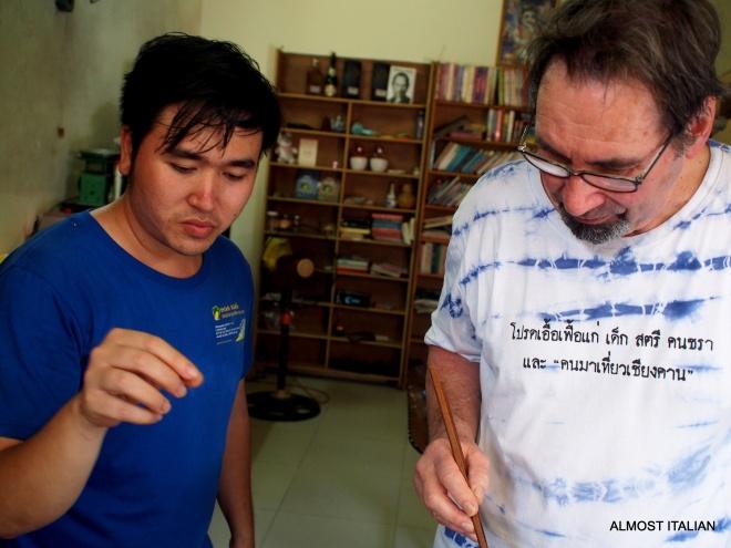 Nhien and Mr T discuss technique in a Vietnamese Kictehn
