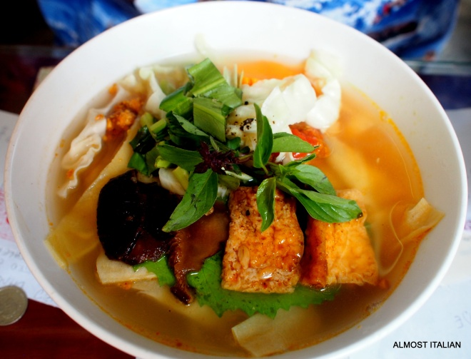 A vegetarian soup made from tow stocks- one a vegetable stock, the other a deep mushroom stock. The soup contains rice noodles, vegetraian wontons, mushrooms, fried tofu and rau ( a kind of green vegetable) and Vietnamese mint. It is deeply satisfying. ( Minh Hiein Restaurant, Hoi An, Vietnam