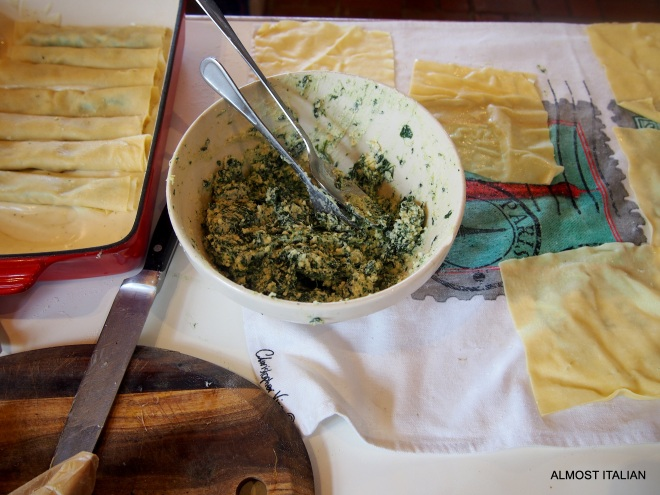 assembling the spinach and riicotta caenneloni