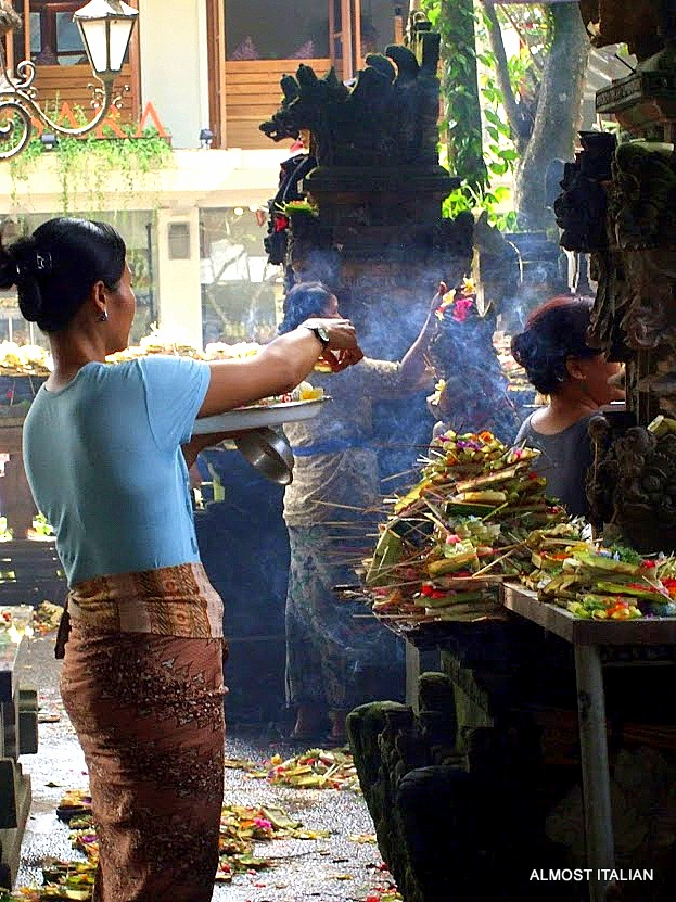 Balinese woman making rirual cremeony at the local Puri ir temple.