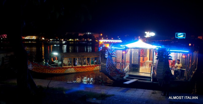 More evening cruise boats along the banks of the Perfume River, Hue, Vietnam