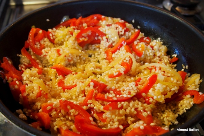 after the onions have softened but not browned, add the rice and stir about until opaque