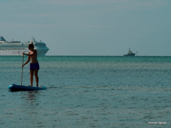 Paddle Board rower or Wayang Puppet? The Norwegian Star in teh background.