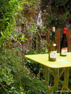 Back yard by the bubbling creek. Stone walls and wine.