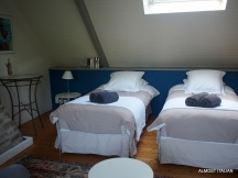 Bedroom on level three. Note, the beds roll togther to make a double. Sort of- double bed with crack.