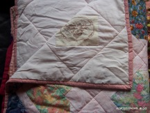 Cot sized quilt with heart designs,
