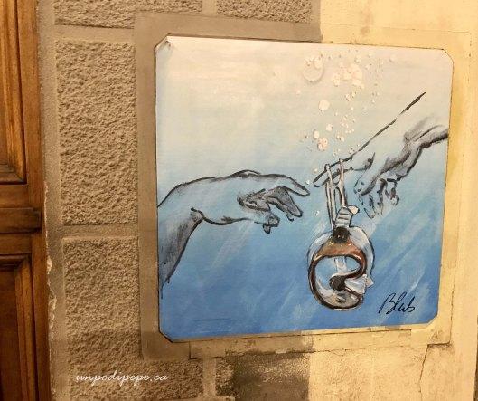 Blub street artist Firenze, the Creation of Adam